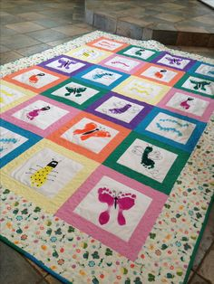 Made using the feet and thumbprints of my daughters's Kindergarten class for her school auction.