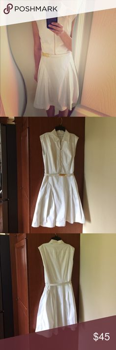"""Calvin Klein, white shift or party dress All white, Cotten-spandex outer shell with polyester lining.. Dress is sleeveless, collared, has a light gold zipper in front and a matching gold-clasped belt.. length is 38 inches, bust 17 inches across, waist 13 inches across.. flared skirt.. hidden side zipper.. Tags removed but dress has never been worn.. dry clean only.. size 4 by Calvin Klein.. (I am 5'3"""" petite frame and it fits me perfectly) Calvin Klein Dresses Midi"""