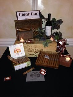 A small cigar bar display by the door with just a couple of types of cigars, a few engraved cutters/lighters and maybe some matches? I assume there will be ashtrays on the patio somewhere? Cigar Bar Wedding, Cigar Party, Gatsby Party, Gatsby Wedding, Wedding Events, Weddings, Wedding Ideas, Havanna Party, Havana Nights Party