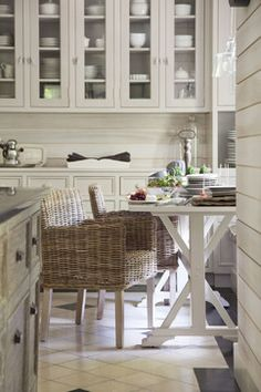 neutral ktichen, gray cabinets, trestle table, rattan dining chairs
