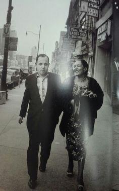 Billie walking with unidentified man.