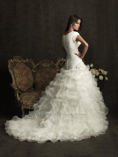 ball gown wedding dress with short sleeves and a beautiful organza skirt