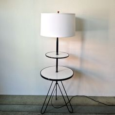 Cool Mid Century floor Lamp with Hairpin Legs, painted black and white, brand new shade, with amber finial.www.alluviumhouse.com