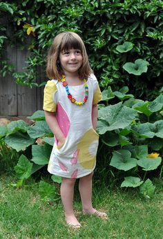 Adorable dress pattern where insets are also pockets. Figgy's Patterns.