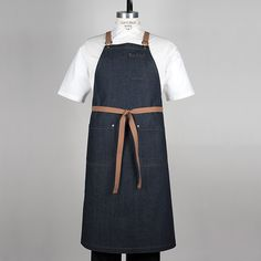 The Giuseppe 0810 is made with 100% Cotton Indigo Denim and has neck saving, Cross Back Ties in a rich, Ranch Tan, 100% Cotton Webbing. This Bib Apron also features; 2 Corner Cut Pockets on the skirt front and 1 Corner Cut, Double Pen Pocket on the Bib for ultra-convenience. All pockets have Double Needle Top Stitching and Nickel Jean Rivets. Removable ties attach to the Bib with Nickel Suspender Buckles. No minimum order required. USD $52.00