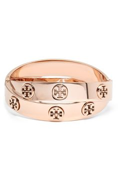 Tory Burch logo studs shine all around this trendy, stacked-looking bracelet in rose gold.