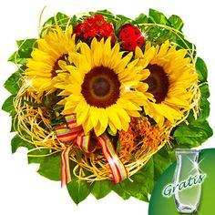 Blumenstrauß Van Gogh mit Vase  Ein Strauß wie gemalt.  Ihr Blumengruß besteht aus 3 Sonnenblumen, 1 orangen Asclepias, 1 roten Bartnelke, 1 roten Marienkäfer, 1 Schleife, 3 Pistochia und 10 Salal in einer gelben Holzmanschette. Der Durchmesser beträgt ca. 30 cm. Dazu erhalten Sie einen Beutel Blumennahrung und eine Pflegeanleitung.  Hinweis: der Marienkäfer kann aus Stoff oder Holz sein.