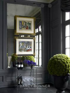 interior design & decor: dark gray, charcoal wall. Art hanging on mirror