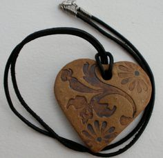 Antique look clay heart pendant