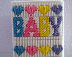 Tissue Box Cover for Baby Room Decor Nursery Needlepoint Pastel Cozy. Designed to fit a boutique size tissue box. Just slip it over the box and add some interest to your baby room decor. Great gift for baby shower. 5 1/2 H X 4 1/2 W  Handmade needlepoint plastic canvas. Hand wash, air dry.  A box of tissues included in your purchase.