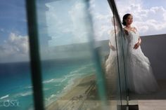 Beautiful bride in a stunning gown by @Mori Simkoff Lee by Madeline Gardner at a destination wedding at @Karen Downing The Vine Cancún . Cancun, Mexico wedding photographers Del Sol Photography.