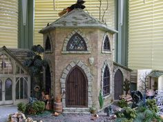 Michelle's Mad World: Witches House - my first project (jt-nice greenhouse conservatory at the side.. is that Humpty Dumpty?)