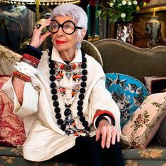 """Iris Apfel looking gorgeous, though """"tame"""" compared to some of usually much more extravagant ensembles, wearing at least 7 necklaces and no fewer than 10-12 bracelets along with (of course) her signature large round black glasses"""