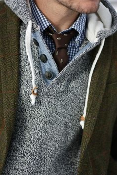 skull and cross bones tie layered under sweater and green blazer