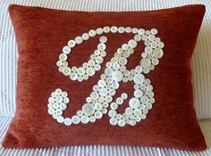 "button-y monogram. Molly gave an ""R"" pillow from here to me for Christmas a couple years ago. It is lovely."