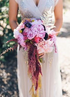 Purple amaranthus drips from this bright and beautiful bouquet giving it an ethereal feel.