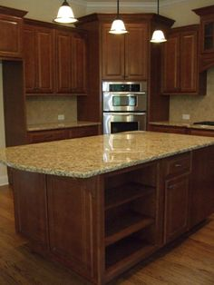 This granite and backsplash would match perfectly with the wood cabinets and wood floors.  Looks like santa cecelia   Kitchen Islands - New Home Ideas - Kitchen Trends - New Home Raleigh NC