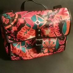 Fossil-   laptop/ipad/tablet bag Style name is Keyper crossbody floral . Gently used great bag. Barely used to carry my iPad and notebooks for work. Light pen mark on inside can be cleaned. Remainder of interior of bag is clean. Fossil Bags