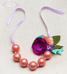 Cute Gumball necklace tutorial! Add a hair clip like shown! What a great party favor or Easter basket gift for a girl!