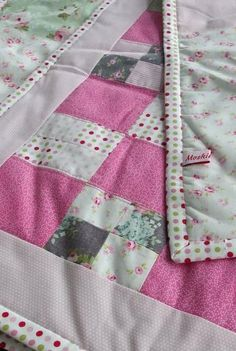 Moski finished quilt in cotton fabrics. 212 x 103 cm big with polyester padding inside.