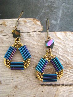 Stunning Peacock Blue Hand Stitched Dangle Earrings  Hand stitched beaded earrings made with peacock blue tubes and antique gold seed beads. The beaded