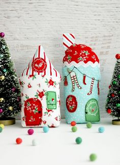 DIY Holiday Village | Create a winter wonderland with this DIY holiday village, featuring 3D fabric houses in festive holiday prints! fabric.com Blog