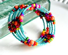colorful memory wire beaded bracelet by pixiestrinkets on Etsy,