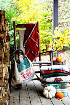 Fall porch decor ideas with rocking chair and tree stump side table-www.goldenboysandme.com