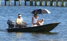 Wayne and Tamara Smith, along with Chaucer, a Cavalier King Charles Spaniel, come ashore at Riverview Park