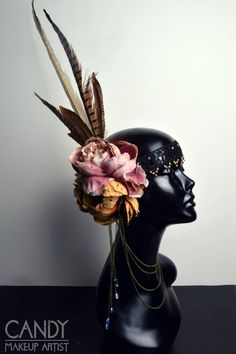 This is a light weight headdress. Ideal for parties and events or if you want to wear it all day long. The decoration is on the right side of the head It's decorated with several, good quality,  orange/ brown and light pink artificial flowers, rhinestones, white and brown feathers, bronze chains and many more small details. The headdress is made with an elastic band on the back for a good fit.  100% handmade