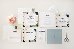 A floral wedding stationery suite, inspired by luscious blooms drawn with pencil on paper. The blooms are paired with clean typography.