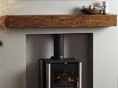 Suspended Railroad Tie Mantle Fireplace Ideas