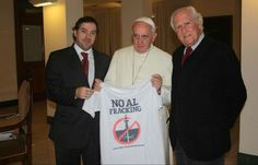 Pope Francis posing for photographs holding up anti-fracking t-shirts following a meeting with a group of Argentinian environmental activist...
