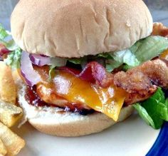 """BBQ Chicken & Bacon Sandwiches: """"This was a perfect summer meal. I put extra BBQ sauce on the bun and topped the chicken with cheddar cheese, shredded romaine and thinly sliced red onions."""" -AZPARZYCH"""