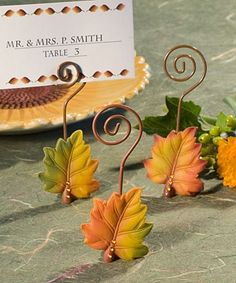 These would be cute to hold the place cards and then they could keep them as their favor! Fall Leaf Wire Twist Place Card Holders by FavorIdeas