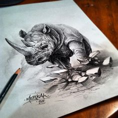 rhino concept sketch for a new tattoo. rhino foot breaking up concrete into pieces, February 2015