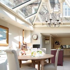 This country-style orangery kitchen is lit by a sparkling roof lantern.