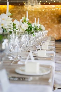 Romantic all-white flower-filled tablescape of orchids, hydrangea  and roses with a touch of greens. Lauren Kriedemann Photography http://www.confettidaydreams.com/franschhoek-wedding-in-white/