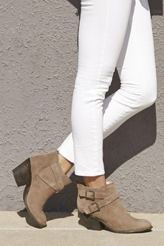 Taupe suede booties with crisscross buckled straps for a rugged, cool look