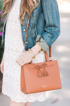 obsessed with this small brown leather bag with the bow tassel - kate spade small isobel bag