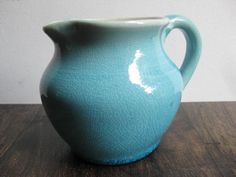 love turquoise vintage pitchers
