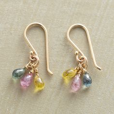 SAPPHIRE RAINDROPS EARRINGS -- Three colors of sapphire raindrops twinkle at the ear...blue, pink and yellow. 14kt gold