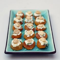 Apricot, Goat Cheese, and Almond Bites. (Suggestion: Before topping with the cheese, put a few drops of reduced balsamic vinegar on the apricot half.)