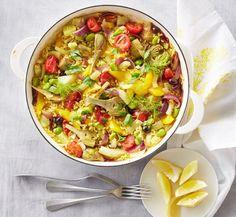 Gemüse-Paella Dicke Bohnen, Artischocken, Fenchel, Oliven und natürlich Reis: ein harmonisches Potpourri aus Farbe und Aroma.