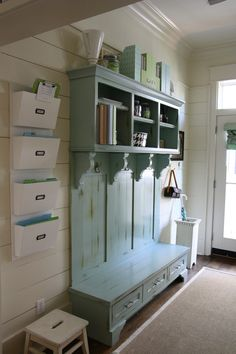Beautiful entryway storage.  I love the kids' folders on the wall too!