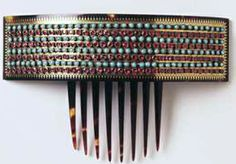 Milan, c. 1890. Tortoiseshell comb with hanged-band heading decorated with gold pique and rows of rubies and turquoise.