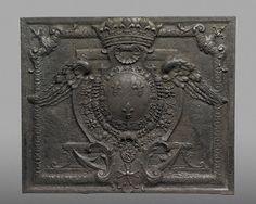 A French fire back, 1703-25, in the form of a crowned heraldic shield bearing fleurs-de-lys, symbols of France. (J Paul Getty Museum)