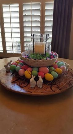 Have fun layering products to create festive centerpieces. This piece has an Easter theme incorporating Mary & Martha Lazy Susan, Heirloom Large Footed Server (no longer available in catalog) and Mary & Martha Small Hand-Blown Glass Lantern.  Accented with egg wreath, foiled wrapped chocolate eggs, paper grass and bunny place card holders. https://www.mymaryandmartha.com/SUSANTONKIN/shop/CATALOG.aspx