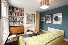 Tamasyn's Eclectic Mid-Century Flat. Blue walls, lime green, collection of styles.