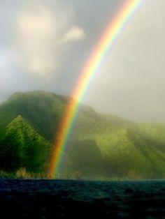 surfsouthafrica:  Tropical rainbows. Tahiti.Photo by Morgan...